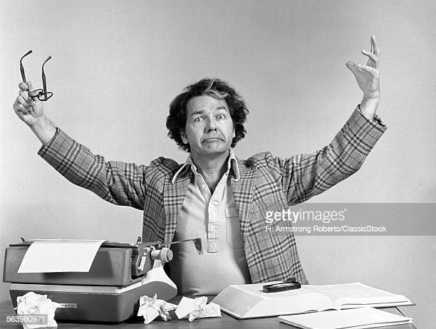 1970s MALE WRITER AT DESK...