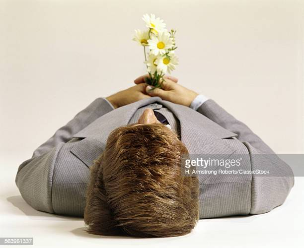 1970s MAN LYING DOWN VIEW...