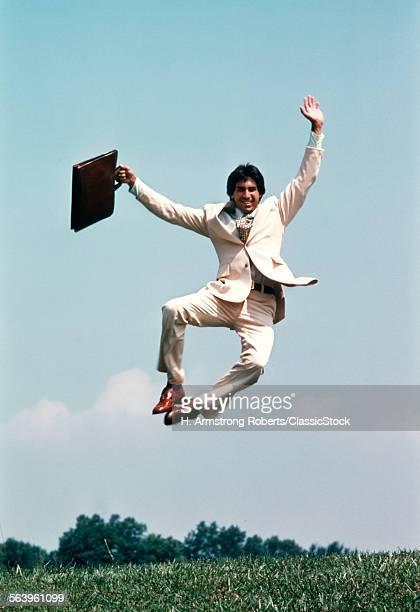 1970s MAN WEARING BUSINESS...