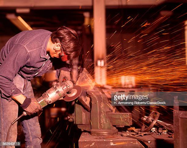 1970s MAN WORKING METAL...