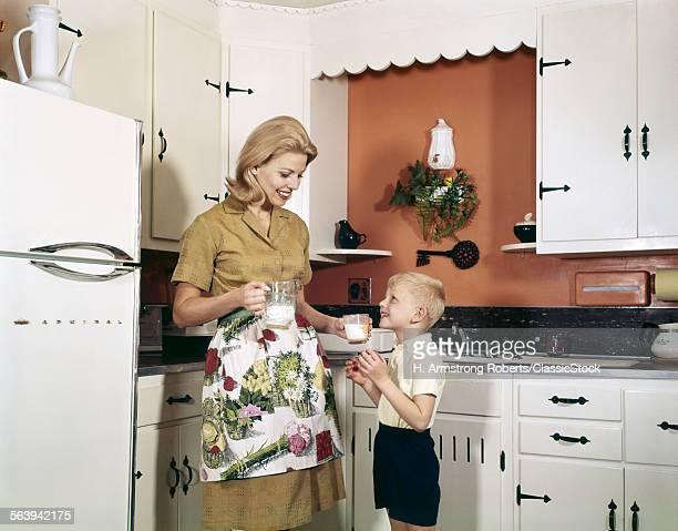 1970s MOTHER HANDING GLASS...