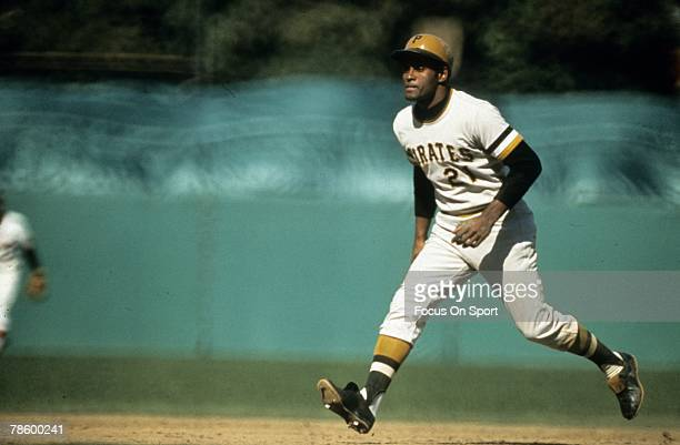 Outfielder Roberto Clemente Pittsburgh Pirates leads off of second base during a MLB baseball game circa early 1970s Clemente played for the Pirates...