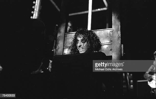 Rock star Alice Cooper's head in a guillotine for his outrageous stage show in June of 1977 in Los Angeles California