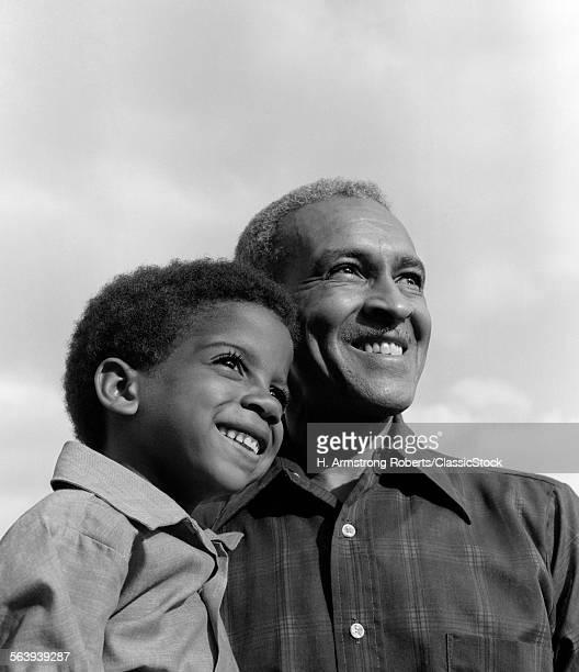 1970s SMILING AFRICAN-AMERI...