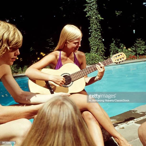 1970s TEEN GIRL PLAYING...
