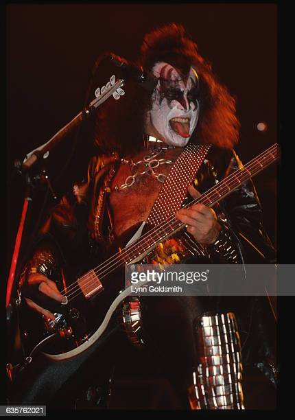 1980Rock and roll band Kiss' bassist Gene Simmons performing wearing costume and makeup and sticking out his tongue