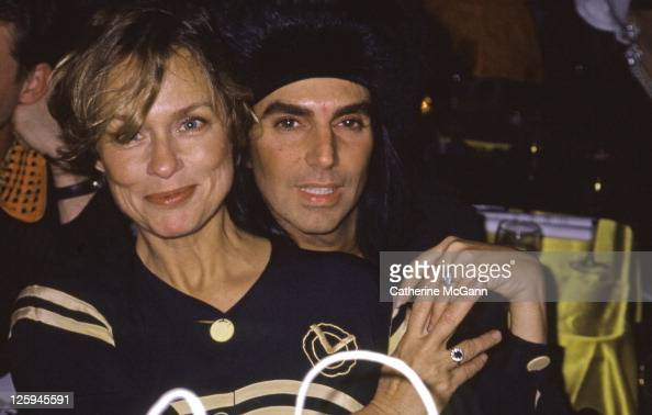 Steven Meisel and Lauren Hutton pose for a photo at an event in the late 1980s in New York City New York