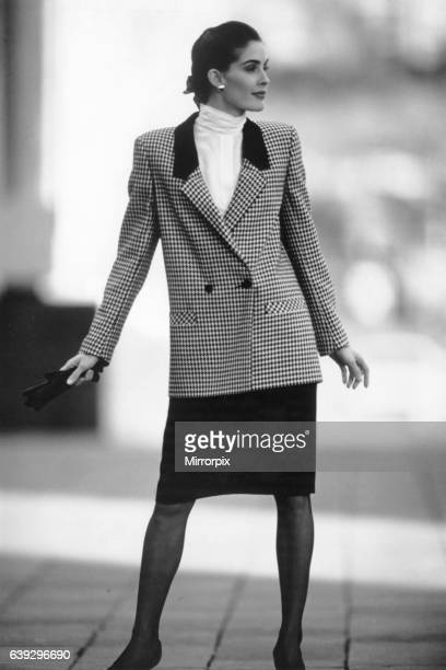 Our model wears Check double breasted jacket with black skirt and high collar blouse 7th November 1988