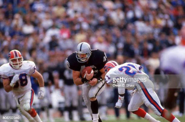 Todd Christensen of the Los Angeles Raiders rushes against the Buffalo Bills at the Coliseum circa 1986 in Los AngelesCalifornia
