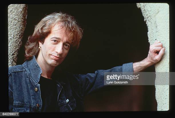 1990Photo shows Robin Gibb sibling member of the singing group The Bee Gees posed in a stone entranceway