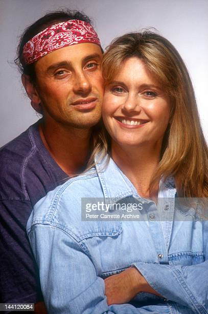 Australian actress and singer Olivia NewtonJohn poses with her husband Matt Lattanzi during a photo shoot in the 1990s in Australia