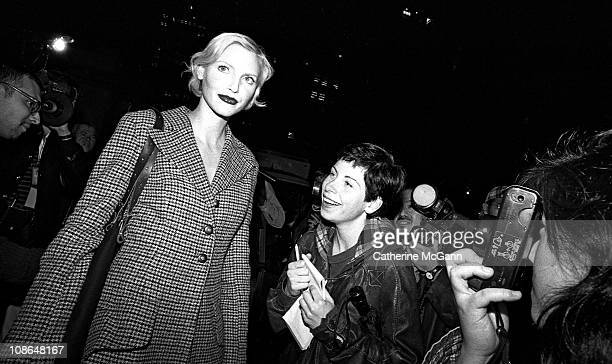 Nadja Auermann and fan during fashion week in the mid 1990s in New York City New York
