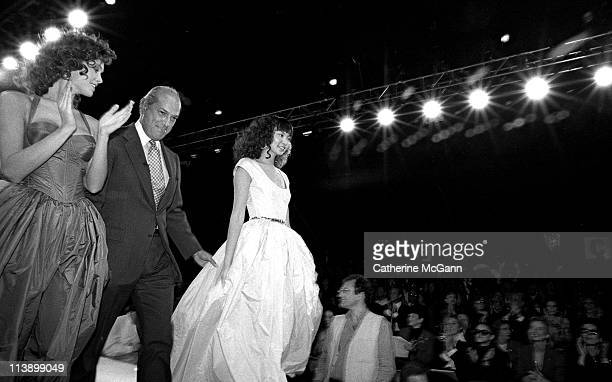 Oscar De La Renta and models on runway after a fashion show in the mid 1990s in New York City New York