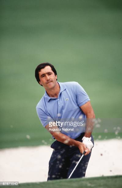 Seve Ballesteros watches his shot out of the bunker during a 1990s Masters Tournament at Augusta National Golf Club in April of the 1990s in Augusta...