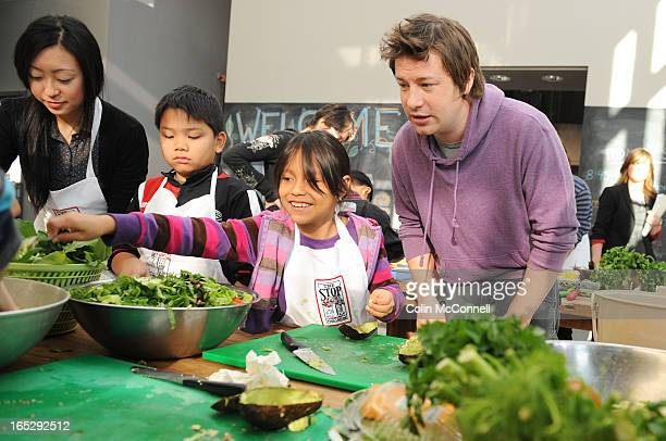 NOV 19th 2010pics of jamie oliver at the artscape food centre on christie street where he talks to and helps around 20 kids make lunch and answers...