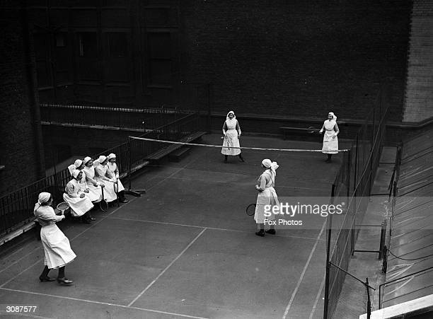 Nurses from Moorfield's eye hospital playing badminton on the hospital roof where a court has been built