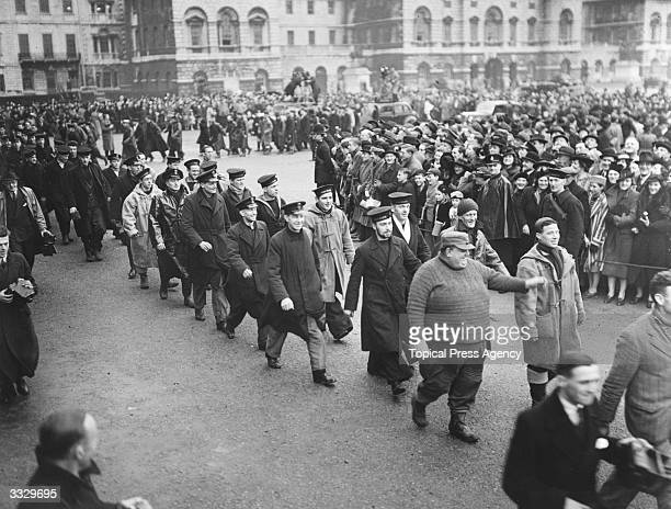 Chief Petty Officer G W Cook known to his shipmates as Tubby arrives with fellow officers and men of destroyer HMS Hardy at Horse Guards Parade...