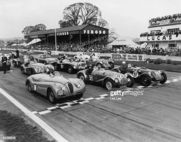 The start of the first Easter Handicap race at Goodwood with E Protheroe in a Jaguar XK 120 R Carnegie in an Allard and E W Cuff Miller also driving...