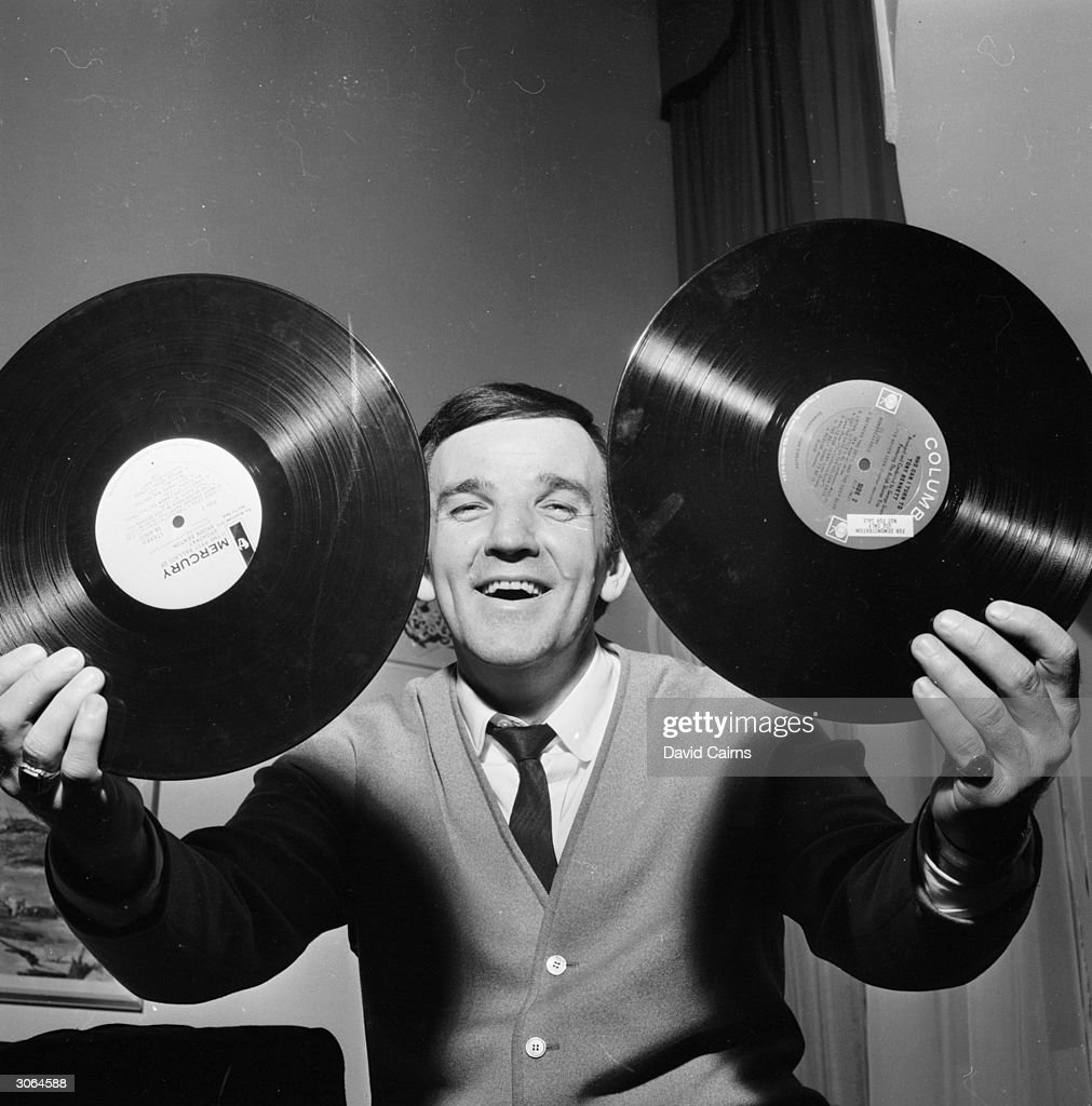 British disc jockey Alan 'Fluff' Freeman with the tools of his trade.