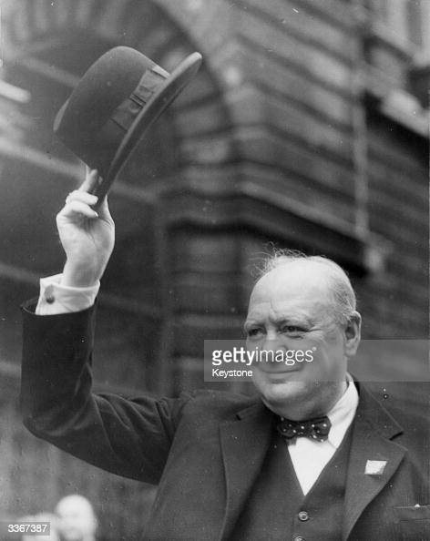Winston Churchill British Statesman and Prime Minister waving his hat to the crowds at Downing Street