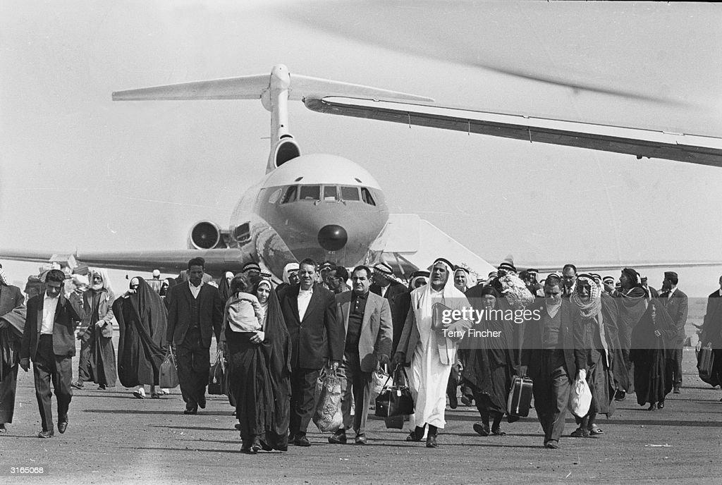 Muslim pilgrims arriving at Mecca airport for the Hajj pilgrimage.