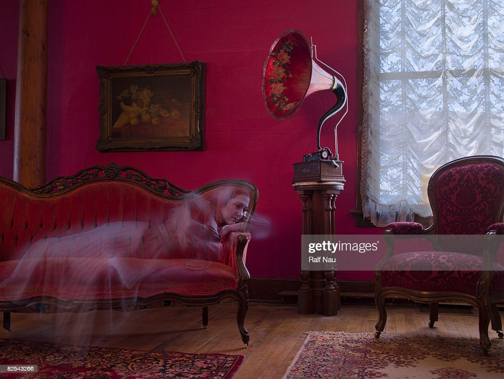 19th century female ghost listening to phonograph