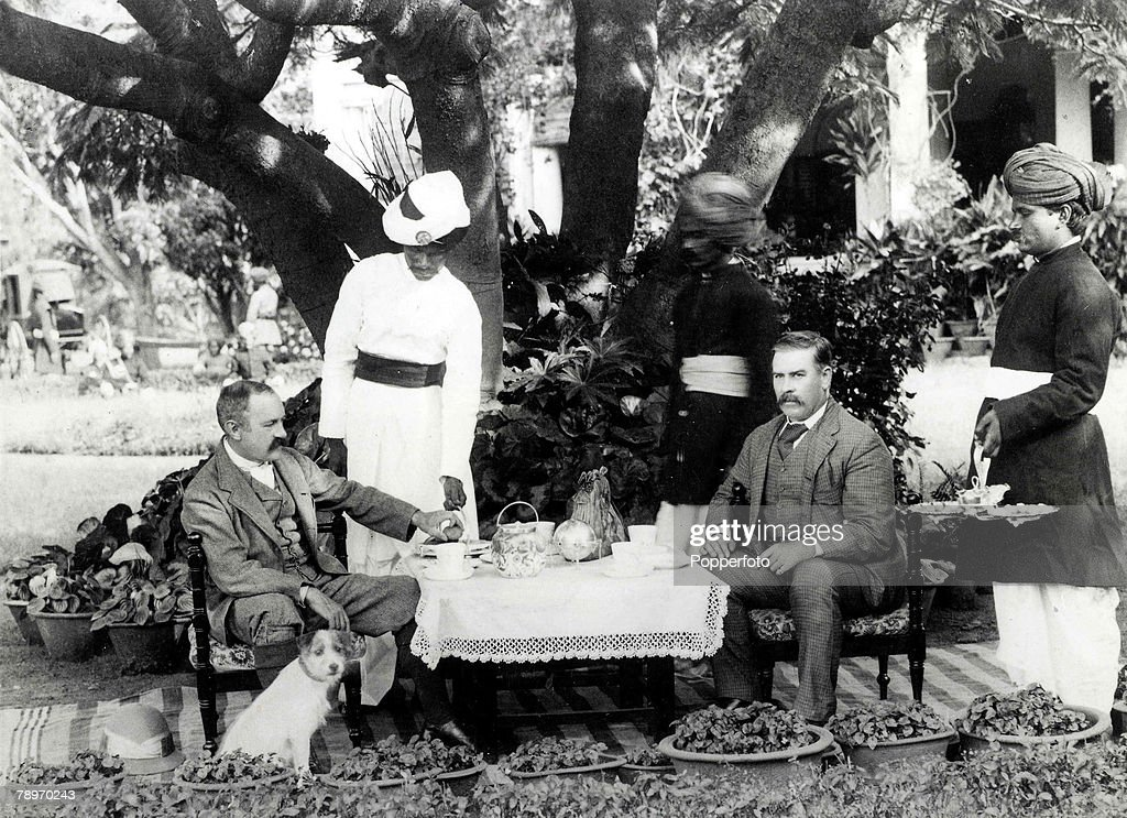 19th Century India servants waiting at a table This picture was taken at Bangalore showing General RGWoodthorpe on the left with his guest Mr Groves...