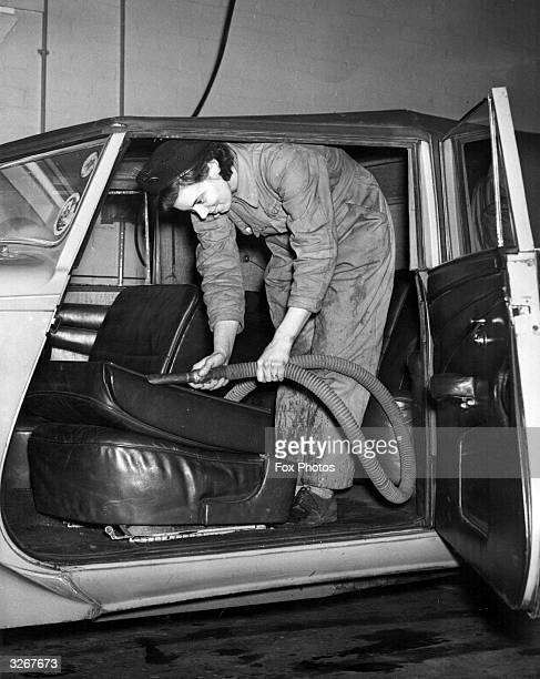 Mrs O Bates of Sheffield vacuumcleans the upholstery of a car before it goes on the conveyor belt at Messrs Kennings Ltd of Sheffield This was the...