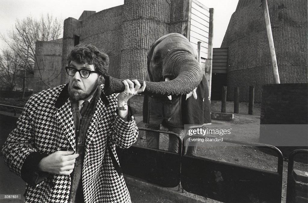 <a gi-track='captionPersonalityLinkClicked' href=/galleries/search?phrase=Rolf+Harris&family=editorial&specificpeople=160469 ng-click='$event.stopPropagation()'>Rolf Harris</a> puts his ear to an elephant's trunk at London Zoo.