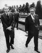 President Nixon walking with the US Secretary of State Henry Kissinger during peace talks in Paris with a view to ending the Vietnam War A year later...