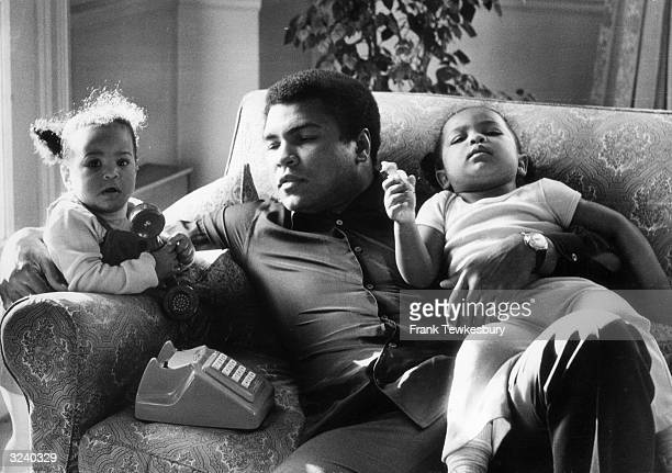 Heavyweight boxer Muhammad Ali with his daughters Laila and Hanna at Grosvenor House