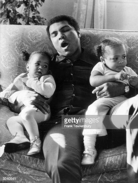 Muhammad Ali yawns while babysitting two of his daughters by wife Veronica Porche 9 month old Laila and 2 year old Hana They are at Grosvenor House...