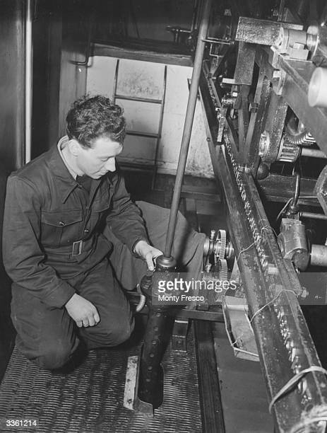 A technician repairing the mechanism of Big Ben in St Stephen's Clock Tower at the Houses of Parliament