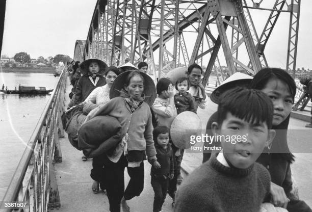 A group of Vietnamese refugees crossing a bridge over the Perfume River
