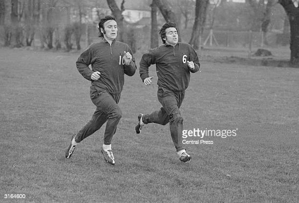 L to r Barry Bridges and Terry Venables of Queens Park Rangers FC during a fast work out before a quarter final FA Cup game Venables is the team...