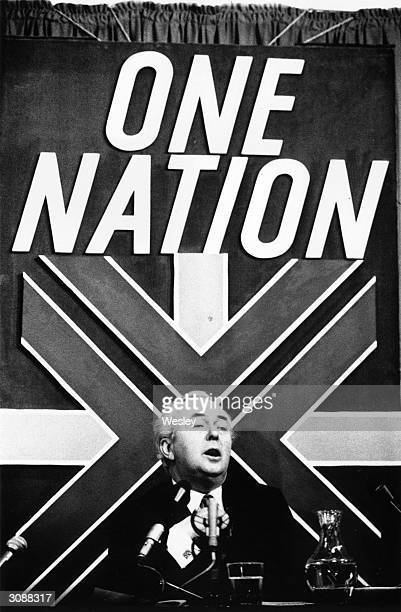 Labour Prime Minister Harold Wilson addressing a press conference at Transport House London His party's rallying cry 'One Nation' is on a banner...