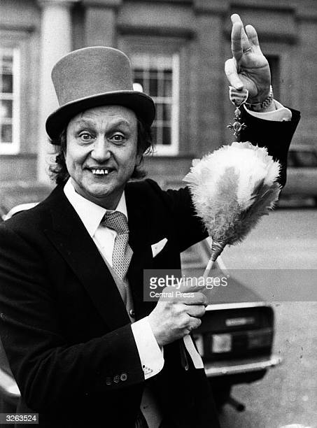 English comedian Ken Dodd with his OBE