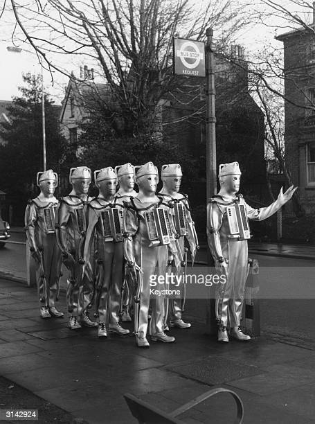 The Cybermen enemies of Dr Who the children's SciFi programme on BBC TV seem to have lost their way and are reduced to queuing at a bus stop