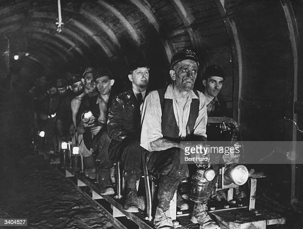 Coal miners are conveyed the long distance to the pit face by rail at Mere Grove Armthorpe near Doncaster Original Publication Picture Post 799 This...