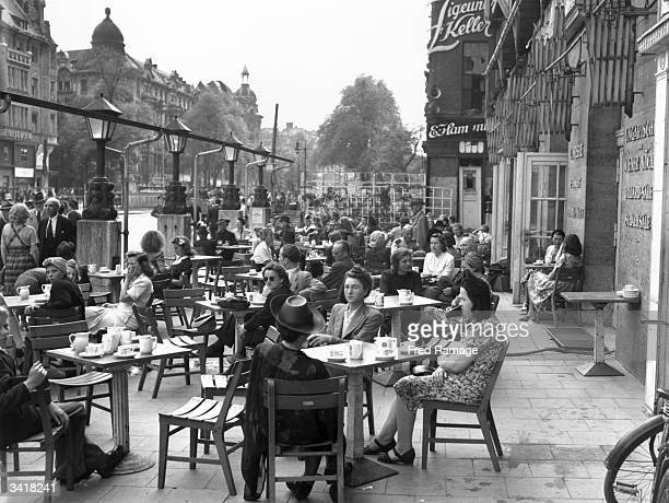 A busy pavement cafe in Berlin its customers drinking ersatz coffee as a result of depleted resources after World War II