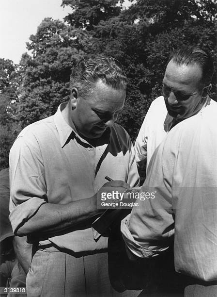 Irish golfer Harry Bradshaw giving a fan an autograph at Wentworth during practice two weeks before the Open Golf Championships Original Publication...