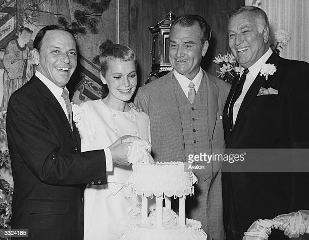 Actor and singer Frank Sinatra with actress Mia Farrow on their wedding day at Las Vegas with Red Skelton