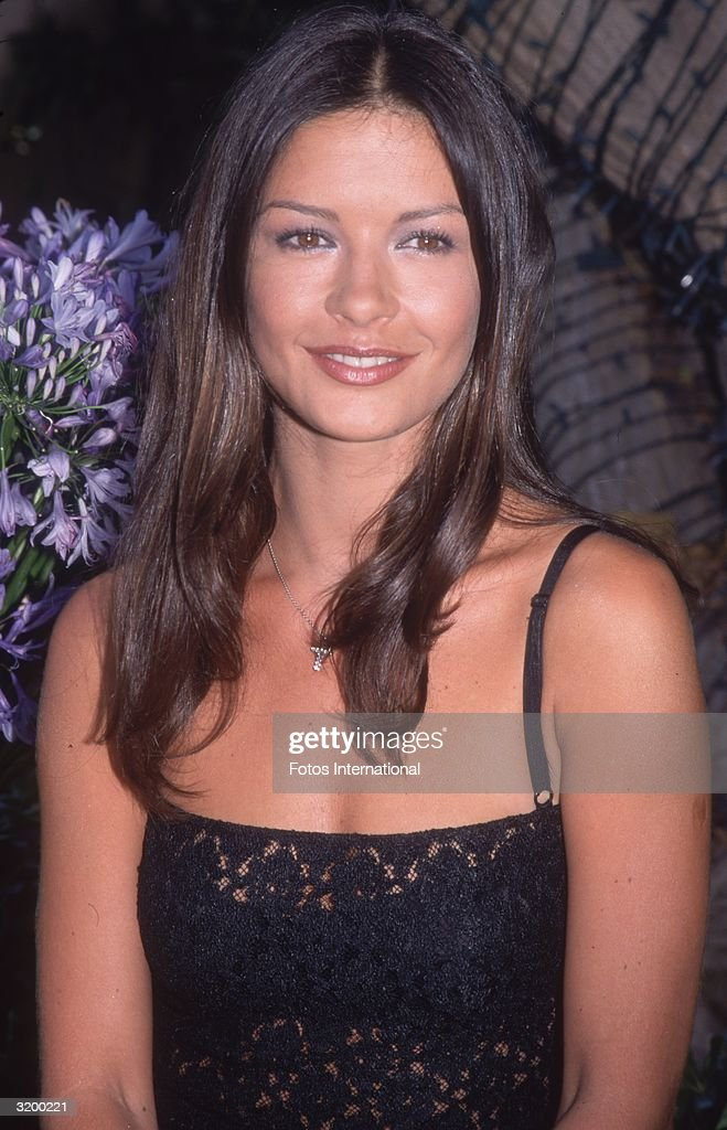 Actress Catherine Zeta Jones wearing a black lace dress outdoors, Beverly Hills, California, July 19, 1999.