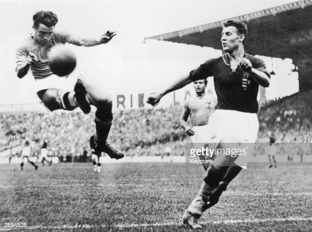 Alfredo Foni of Italy tries in vain to reach a cross during the FIFA World Cup Final against Hungary played in Paris France Italy won the match and...