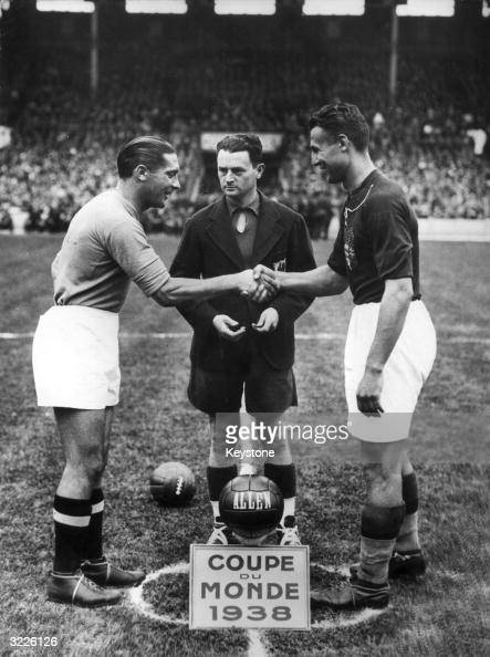 Italian captain Giuseppe Meazza shakes hands with Hungarian captain Gyorgy Sarosi at the start of the FIFA World Cup final in Paris Italy beat...