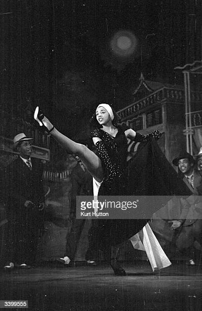 23 year old actress and dancer Mabel Lee highkicks her way out of her dress in a scene from the show 'Calypso' at the London Playhouse Original...