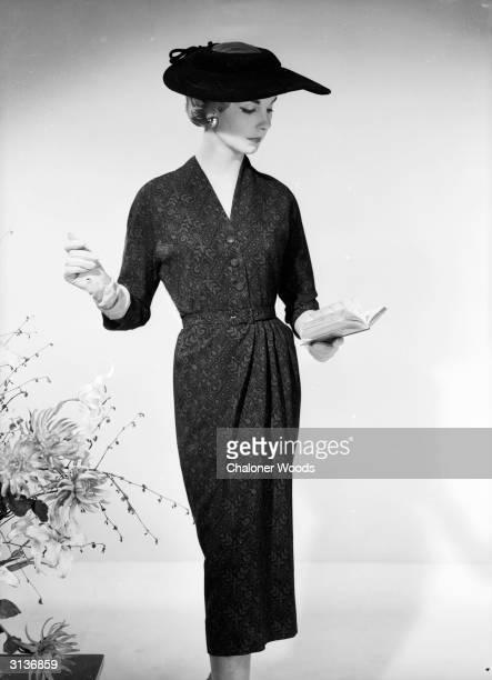 A woman in a Brilkie dress gathered at the waist consults her diary for her upcoming engagements