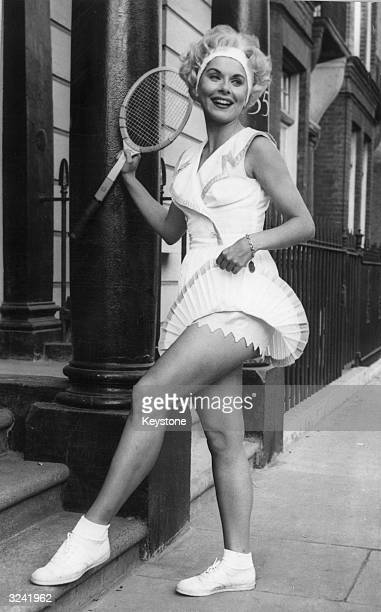American tennis star Karol Fageros displaying her latest Wimbledon 'look' designed by Teddy Tinling It consists of a blonde wig worn with a bandeau...