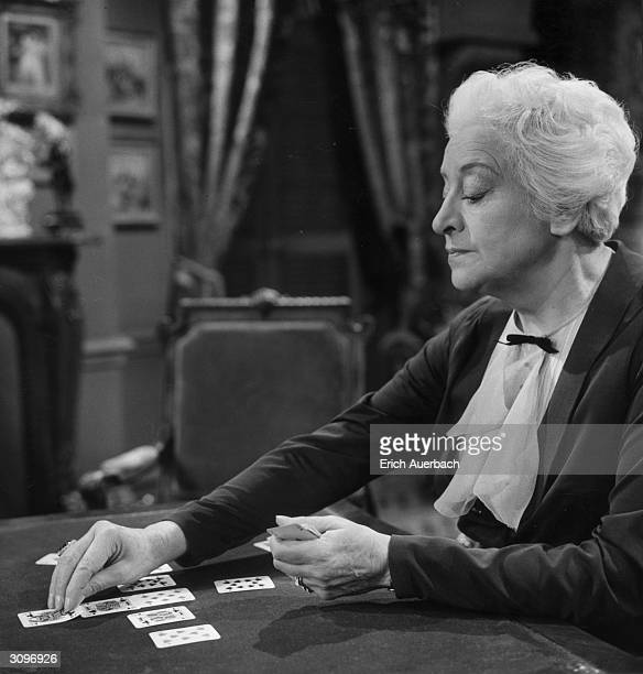 Actress Francoise Rosay plays a game of solitaire in the BBC television drama 'Solitaire'