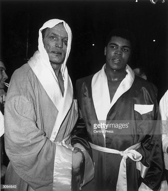 US heavyweight boxer Cassius Clay and English boxer Henry Cooper shake hands after Clay's victory over the British heavyweight champion in a nontitle...